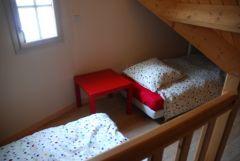 mezzanine RDC avec deux lits simples