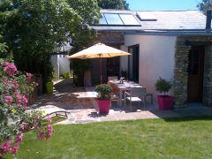 Terrasse donnant sur le jardin privatif