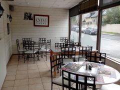 La salle de restaurant en véranda