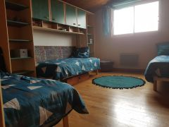 chambre verte 3 lits simples